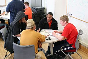 group of male students at a table